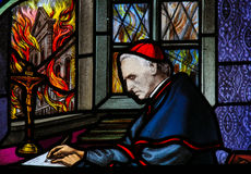 Cardinal Mercier - Stained Glass. Stained Glass window depicting Cardinal Mercier (1851 - 1926), writing his pastoral letter, Patriotism and Endurance, during Stock Image