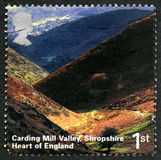 Carding Mill Valley UK Postage Stamp. GREAT BRITAIN - CIRCA 2006: A used postage stamp from the UK, depicting an image of Carding Mill Valley in Shropshire Royalty Free Stock Image