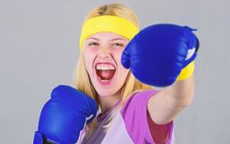 Cardio boxing exercises to lose weight. Woman exercising with boxing gloves. Girl learn how defend herself. Femininity. And strength balance. Woman boxing royalty free stock images
