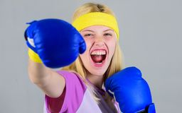 Cardio boxing exercises to lose weight. Woman exercising with boxing gloves. Girl learn how defend herself. Femininity. And strength balance. Woman boxing stock photo