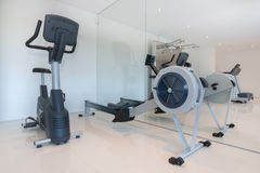 Cardio fitness equipment in the gym. Royalty Free Stock Images
