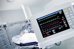 Cardio monitor in working with the patient Stock Images