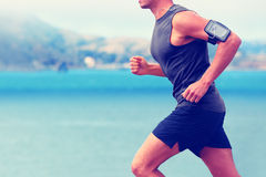 Cardio runner running listening smartphone music stock photography