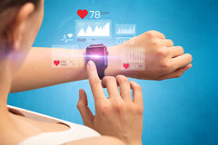 Cardio and smartwatch. Stock Photography