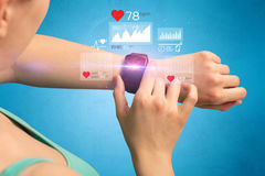 Cardio and smartwatch. Female hand with smartwatch and health application icons nearby Stock Photos