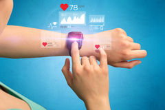Cardio and smartwatch. Female hand with smartwatch and health application icons nearby Royalty Free Stock Photography