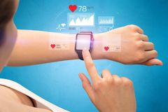 Cardio and smartwatch. Female hand with smartwatch and health application icons nearby Stock Photography