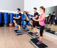Cardio step dance group at fitness gym training Stock Photography