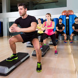 Cardio step dance squat group at fitness gym. Cardio step dance squat people group at fitness gym training workout Stock Photography