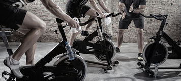 Cardio training on bicycle. Sport and healthy lifestyle royalty free stock photography
