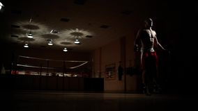 Cardio training boxer on the ring. Jumping rope. Cardio training boxer on the ring stock video footage