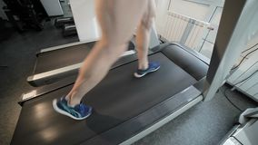 Cardio training on a treadmill. Cardio workout on the treadmill, sports walking warm-up before training stock video footage