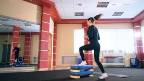 Cardio training. Young sporty woman exercising in the gym. stock video footage