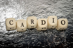 Cardio. Word letters unevenly on a wooden cubes on a shiny silver background stock photo