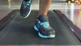 Cardio workout, Afro-American man exercising on treadmill in the gym, close-up. Stock footage stock video