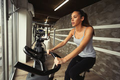 Cardio workout in gym. By beautiful female stock photography