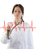 Cardiogram. Nice doctor with stethoscope auscultating the focus is on the stethoscope royalty free stock photo
