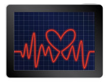 Cardiogram with heart on a tablet Stock Photo