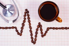 Cardiogram line of coffee grains, cup of coffee and stethoscope, medicine and healthcare concept Stock Images