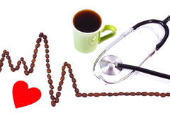 Cardiogram line of coffee grains, cup of coffee and stethoscope, medicine and healthcare concept Stock Photo