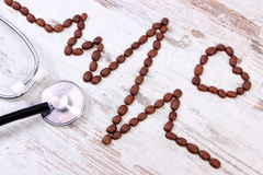 Cardiogram line of coffee grains and medical stethoscope, concept of medicine and healthcare Stock Photo