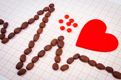 Cardiogram line of coffee grains, red heart and supplement pills, medicine and healthcare concept Stock Photo