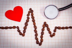 Cardiogram line of coffee grains, stethoscope and red heart, medicine and healthcare concept Stock Images