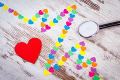 Cardiogram line of paper hearts and stethoscope on wooden background, medicine and healthcare concept Royalty Free Stock Photography