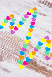 Cardiogram line of paper hearts on wooden background, medicine and healthcare concept Stock Image