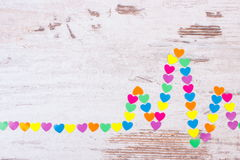 Cardiogram line of paper hearts on wooden background, medicine and healthcare concept Stock Photos