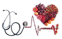 Cardiogram made from food. Cardiogram icon with heartshape made from food and stethoscope Royalty Free Stock Images