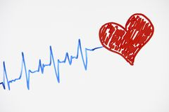 Cardiogram pulse trace and red heart. Concept for cardiovascular medical exam on a white background with copy space, top view. Healthcare concept Royalty Free Stock Photos