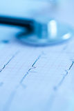 Cardiogram with stethoscope Stock Photos