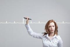 Cardiogramme de dessin de femme de docteur Photographie stock