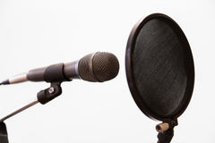 Cardioid condenser microphone, headphones and pop filter on a gray background. Home recording Studio Royalty Free Stock Images