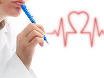 Cardiologist. Female doctor holding blue pan in hand stock image