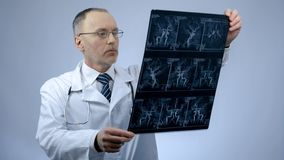 Cardiologist checking CT scan of blood vessels, heart disease, arrhythmia. Stock photo stock photos