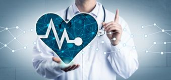 Free Cardiologist Holding AI Aided Virtual Pulse Trace Stock Image - 155539031