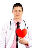 A cardiologist holding a heart next to his chest Royalty Free Stock Image
