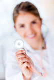 Cardiologist holding stethoscope Stock Photos