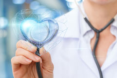 The Cardiologist listens to the heart . stock photos