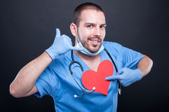 Cardiologist pointing red heart shape showing calling gesture Stock Photos