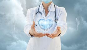 Cardiologist shows a heart in the sky. stock image