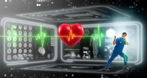The cardiologist in telemedicine concept with heart beat. Cardiologist in telemedicine concept with heart beat royalty free stock photo