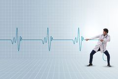 The cardiologist in telemedicine concept with heart beat. Cardiologist in telemedicine concept with heart beat stock photography