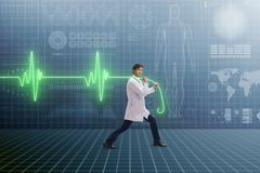 The cardiologist in telemedicine concept with heart beat. Cardiologist in telemedicine concept with heart beat royalty free stock images