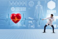 The cardiologist in telemedicine concept with heart beat. Cardiologist in telemedicine concept with heart beat royalty free stock photography