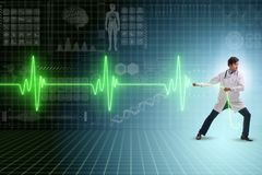 The cardiologist in telemedicine concept with heart beat. Cardiologist in telemedicine concept with heart beat royalty free stock image
