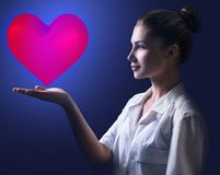 Cardiologist woman doctor holding big red heart. Healthcare concept stock images