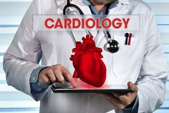 Cardiologist working with digital tablet and simulate interface stock photo